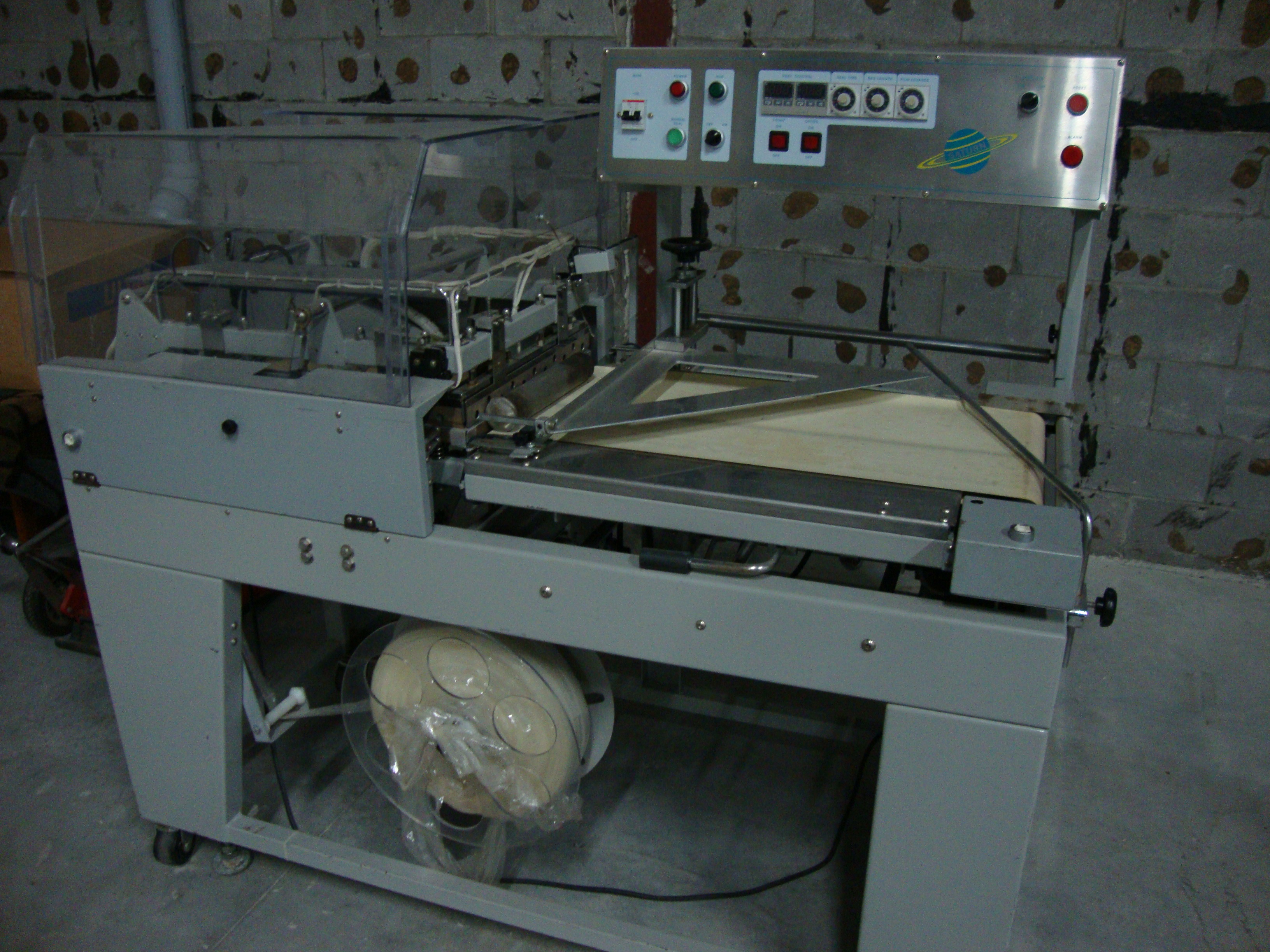 Saturn l bar sealer and heat tunnel a t j canada inc for Food bar packaging machine